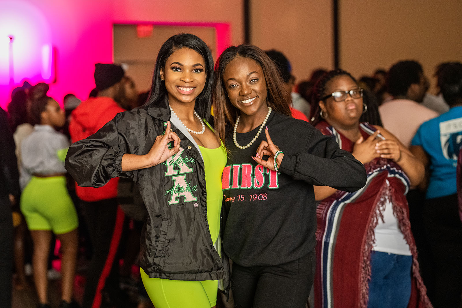 Two students member of a sororities at a event.