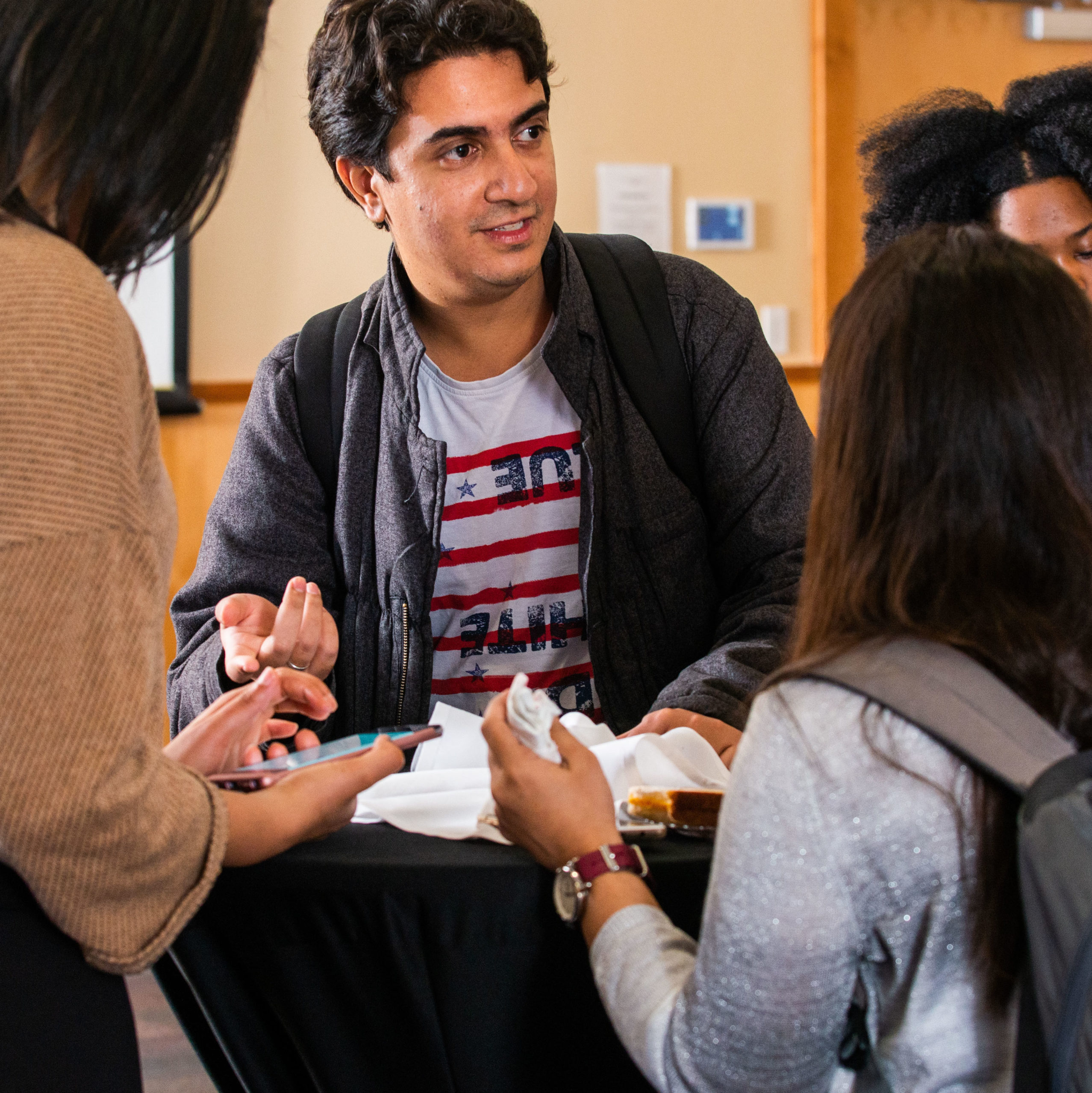 A group of student talking at a table.