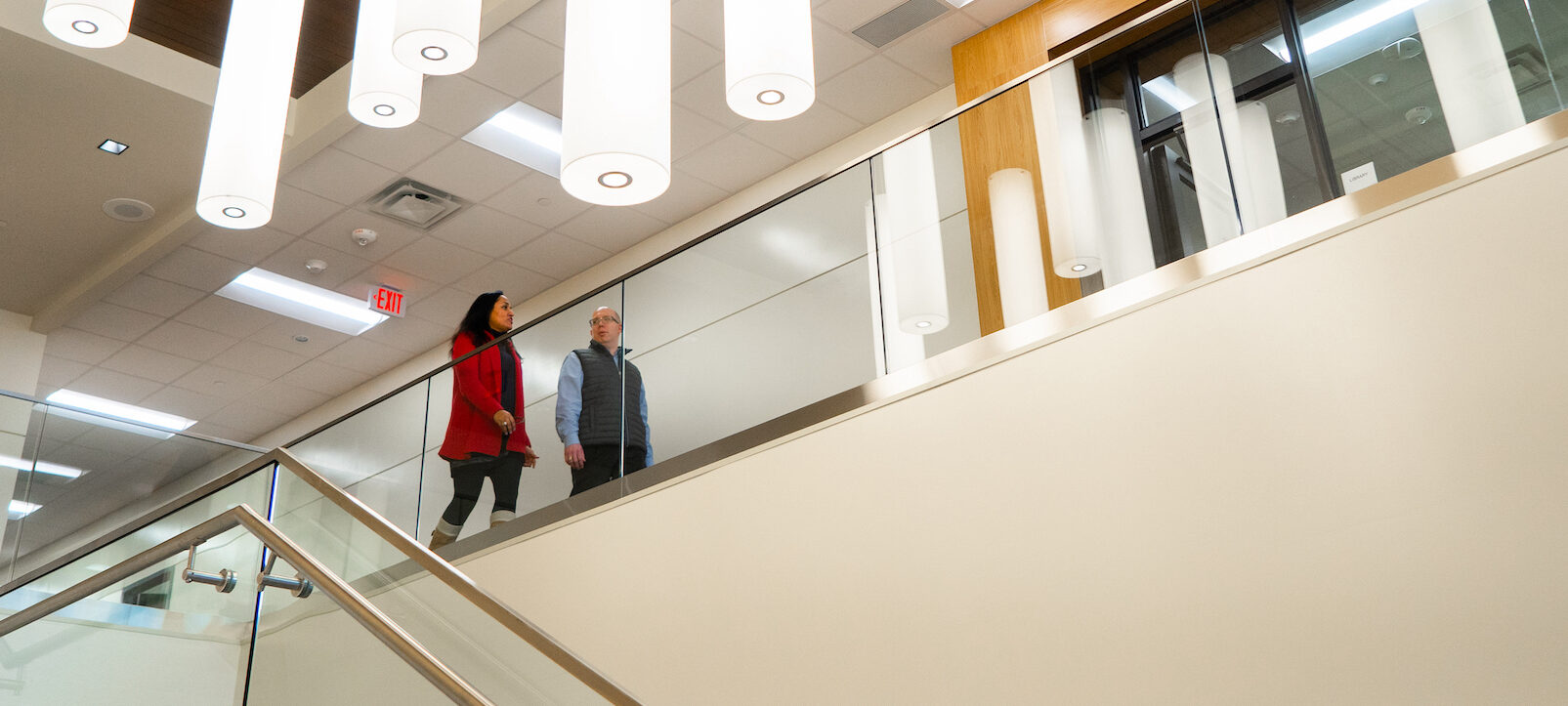 Two people walking in the Mesquite Metroplex Center