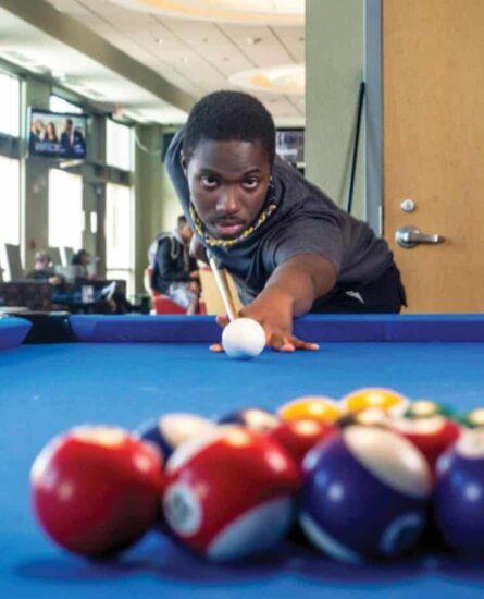 Student playing pool.