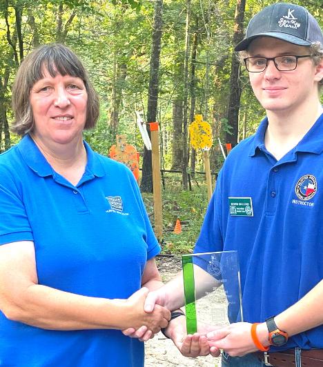 Caleb Painter receives his award