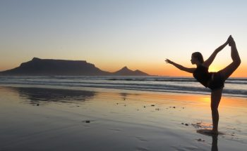 Woman Doing Yoga in Front of Table Mountain