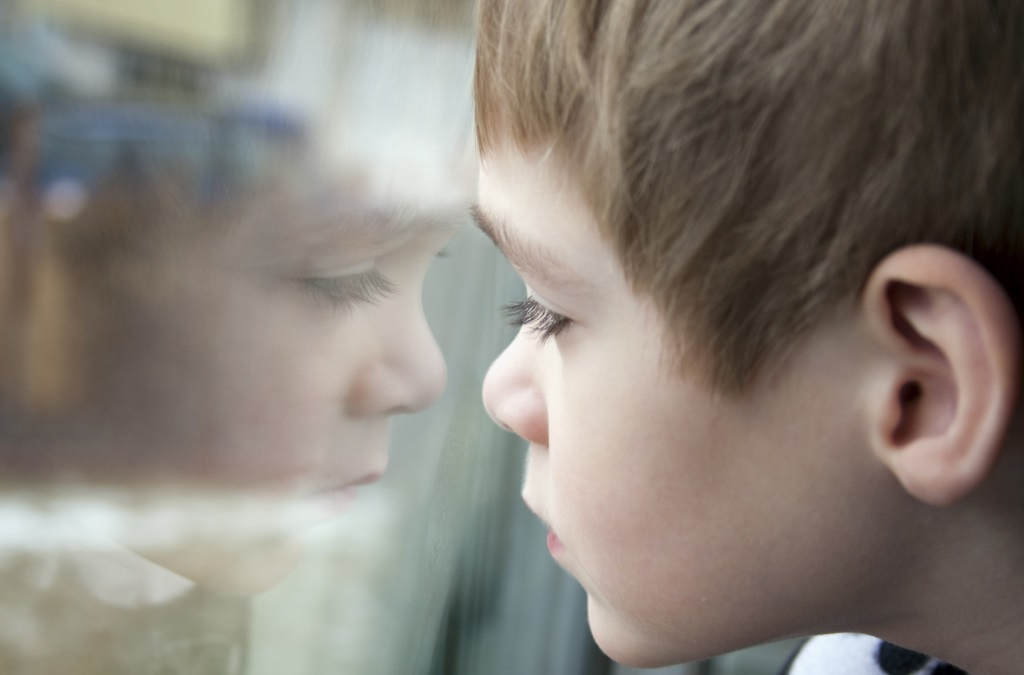 Boy Looking Through a Window