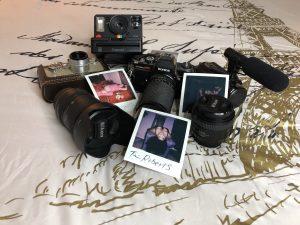 cameras, lenses, polaroid pictures