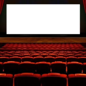 Theater hall with red seat and wide blank white screen