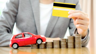 99924f85 31660654 businesswoman hand hold credit card a toy car and a stack of co scaled