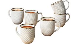 Set de tazas con textura color crema.