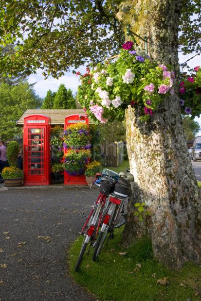 I5D1409 PHONE BOXES AND CYCLES AT TRALEE MEDIUM