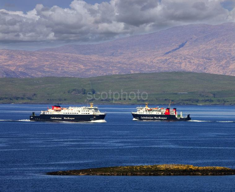 Two Ferries Pass In Sound Of Mull