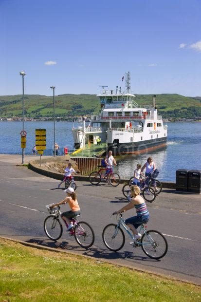 Cyclist On Cumbrae Island With Largs Ferry