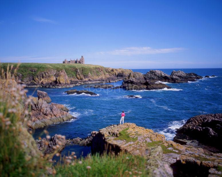 Rugged Coastline With Slains Castle Cruden Bay Aberdeenshire