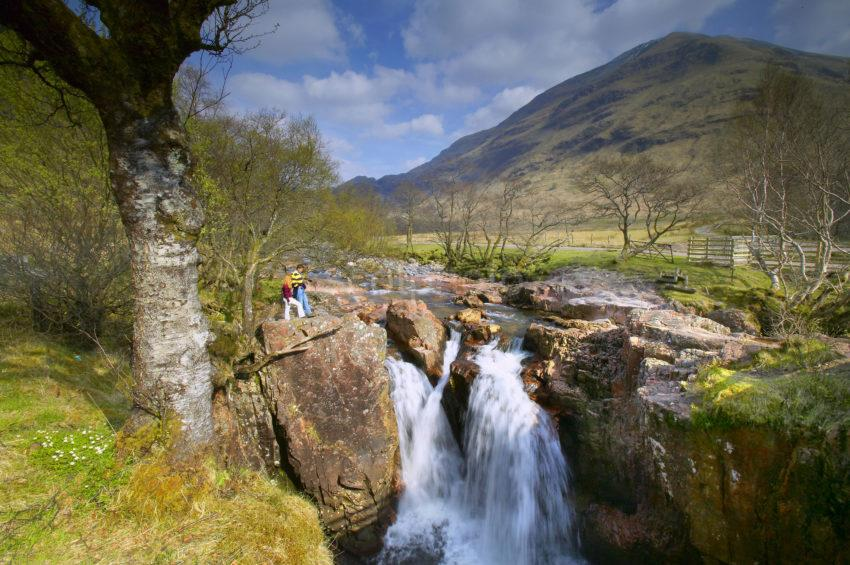 Tourists Visit The Waterfalls In Glen Nevis