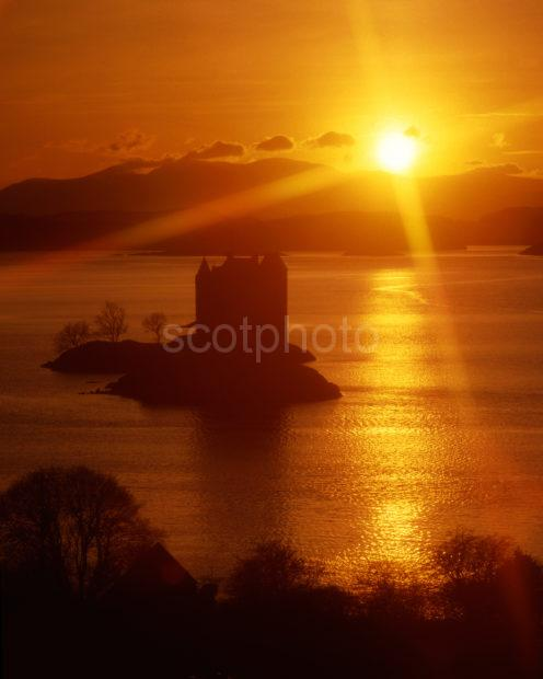 Starburst Sunset Over Castle Stalker And Morvern Hills From Appin