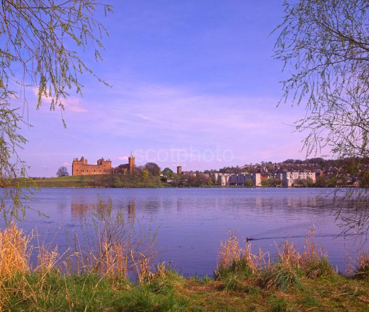 A Pleasant Springtime View From The Shore Of Linlithgow Loch Towards Linlithgow And The Palace Midlothian