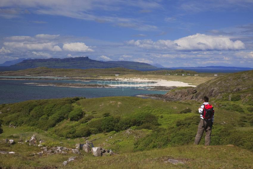 Hiker Towards Eigg And Rum From Sanna Bay