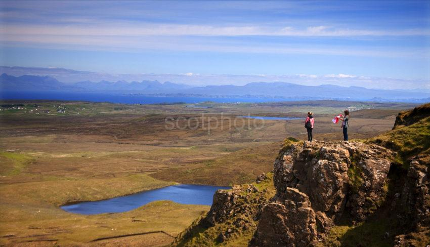 Tourists At Dramatic Viewpoint At Storr Isle Of Skye