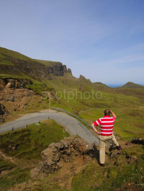 Tourist Enjoys Dramatic View From Quiraing To Storr Rock Staffin Skye