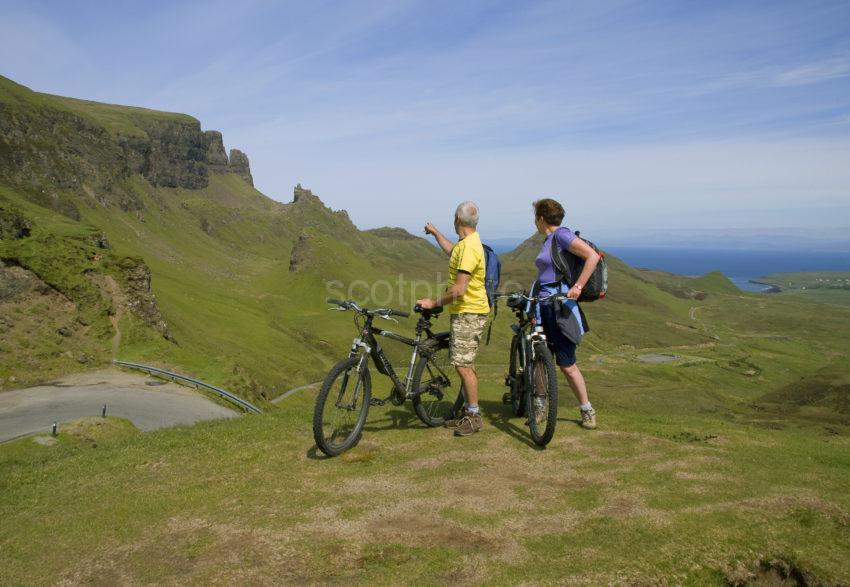 Two Cyclists Pause To Take In View At Quiraing Pass Skye