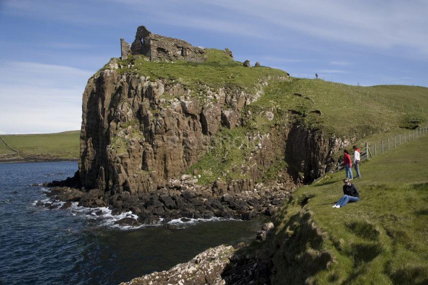 WY3Q8482 Tourist At Duntulm Castle On Dolerite Cliffs Trotternish Skye