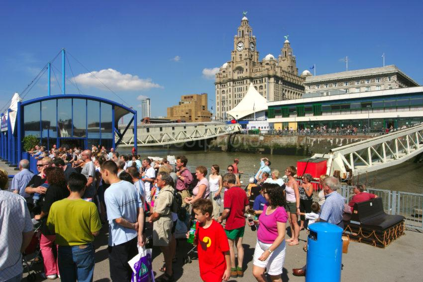 Tourist Await The Ferry At The Pier Head
