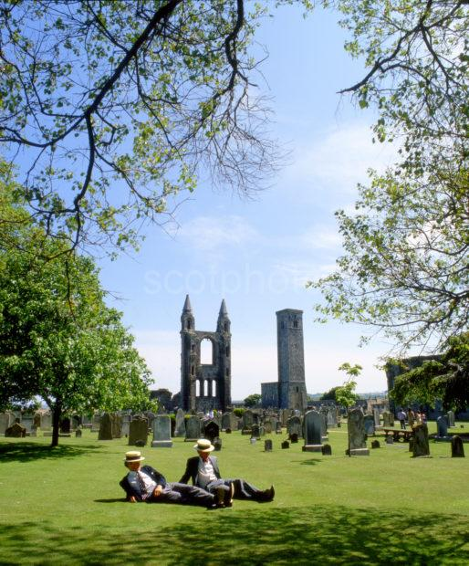 Students Relax In St Andrews By Cathedral Ruins Fife