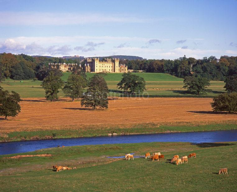 Looking Towards The Magnificent Palatial Stately Home Of Floors Castle As Seen From Across The River Tweed Roxburghshire