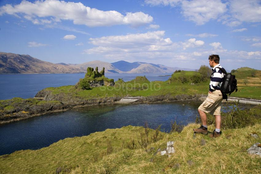 WY3Q9887 Hiker At Castle Coeffin Isle Of Lismore