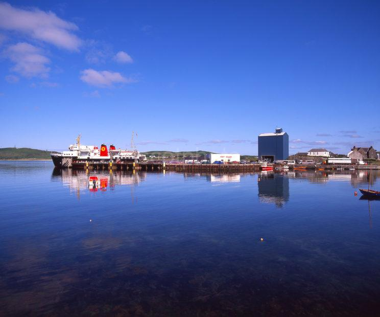 Peaceful Reflections Of The MV Isle Of Arran Berthed At Port Ellen Islay Argyll