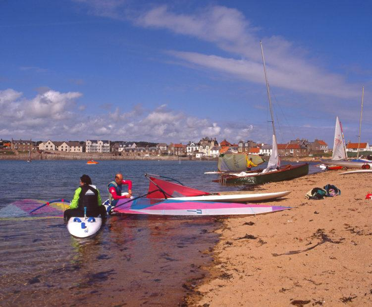 Colourful Beach Scene On A Summers Day At Ellie A Small Harbour Town On The East Neuk Of Fife Scotland