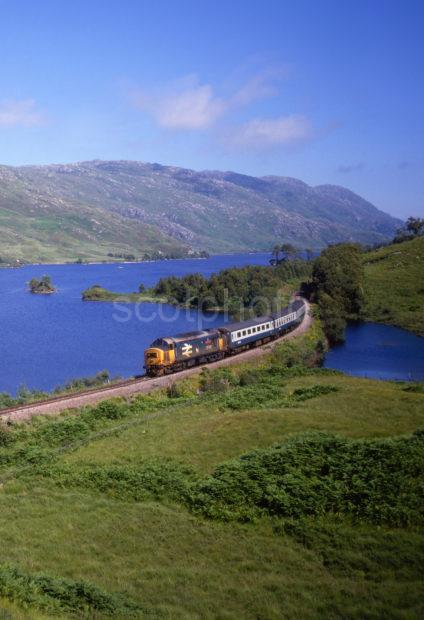 Class 37 Heads The Fort William To Mallaig Train Past Loch Eilt West Highland Line