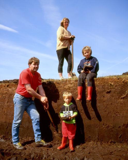 Family Cutting Peat On Skye