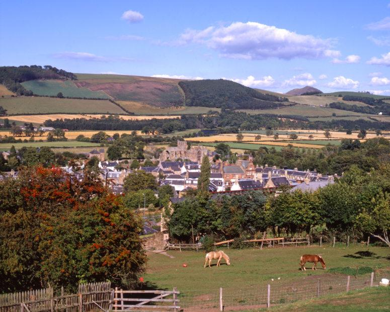View Of Melrose Town And Abbey Ruins Melrose Scottish Borders