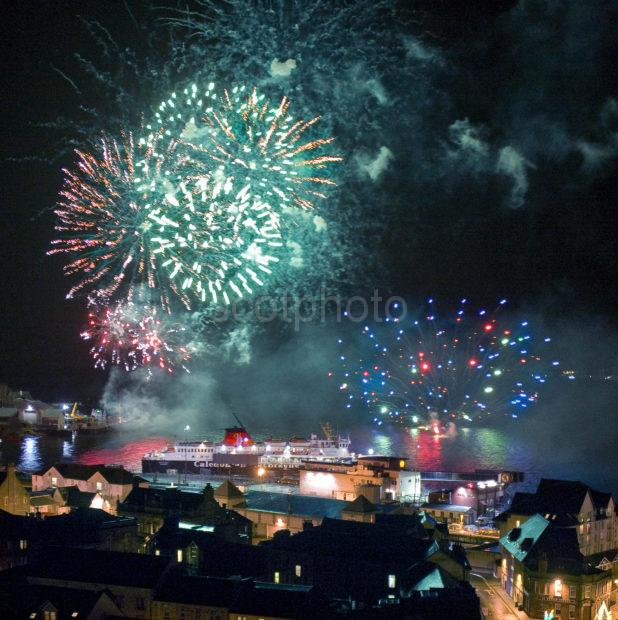 Fireworks Oban Bay With Mull Ferry At Rail Pier