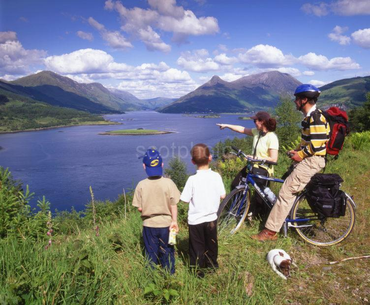 CYCLING ON CYCLEWAY ABOVE BALLACHULISH AND LOCH LEVEN