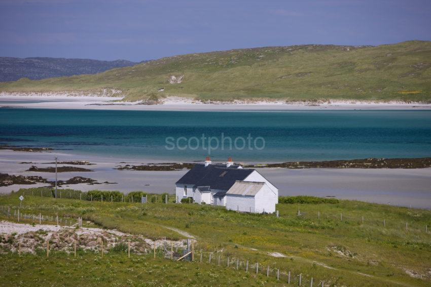 Whitewashed Croft With Green Water North Barra