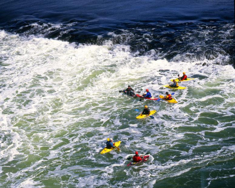 Canoes Ride The Rapids At Falls Of Lora