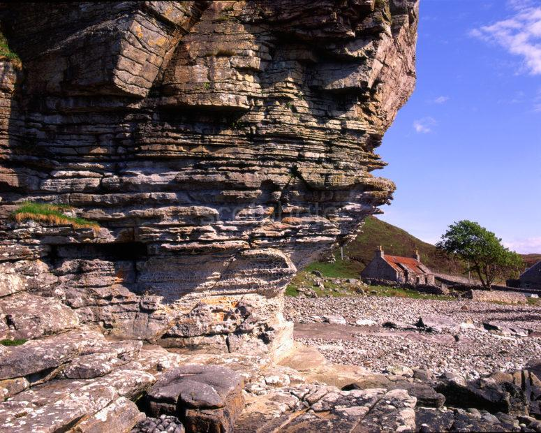 Honeycomb Weathered Cliffs At Elgol With Croft Island Of Skye