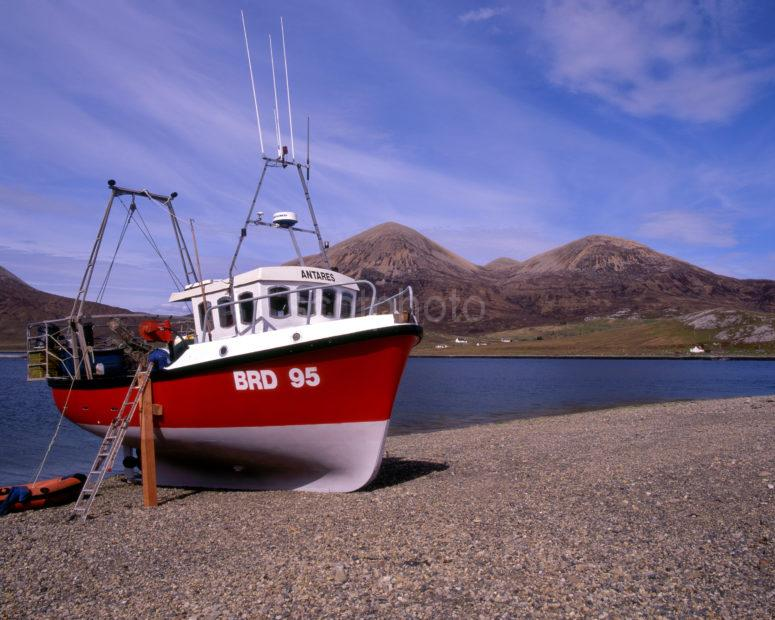 Fishing Boat On Shore Of Loch Slapin With The Red Hills Island Of Skye