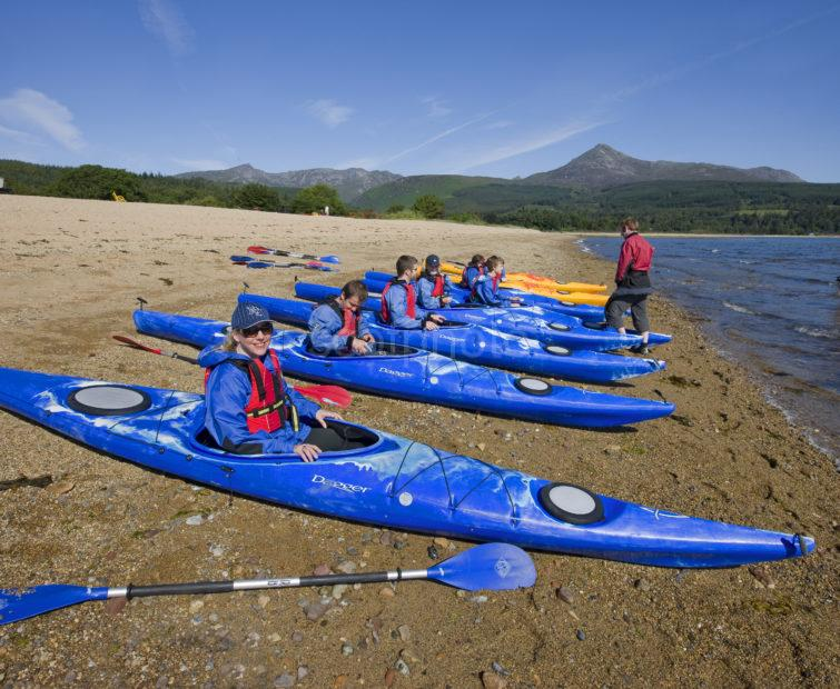 I5D0205 Canoes On Shore At Brodick With Goat Fell In Distance Arran