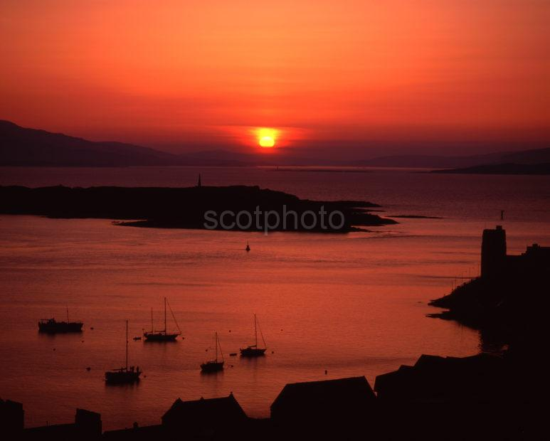 Sunset Silhouette Across Oban Bay With Kerrera And Mull Argyll
