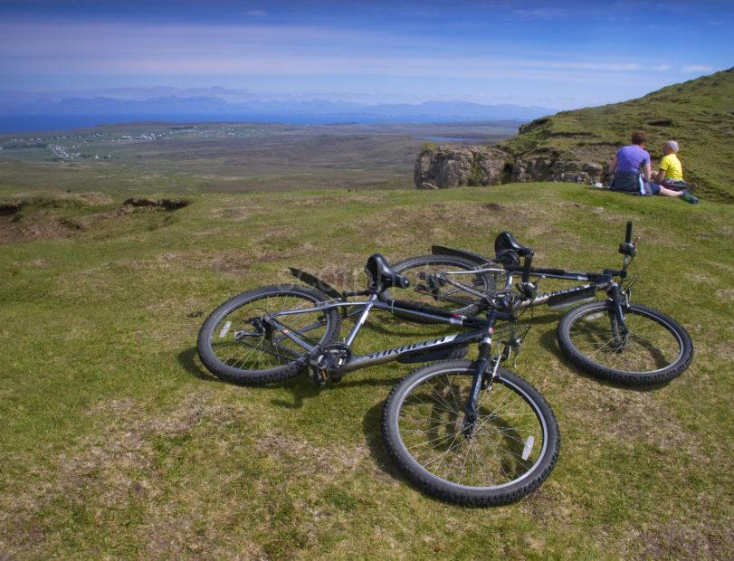 Cyclists Pause And Enjoy The View Quiraing Skye
