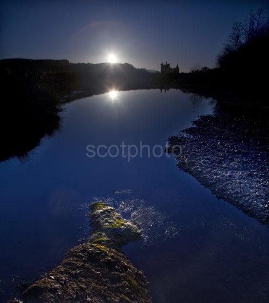 Starburst Silhouette Over Kilchurn Castle Loch Awe