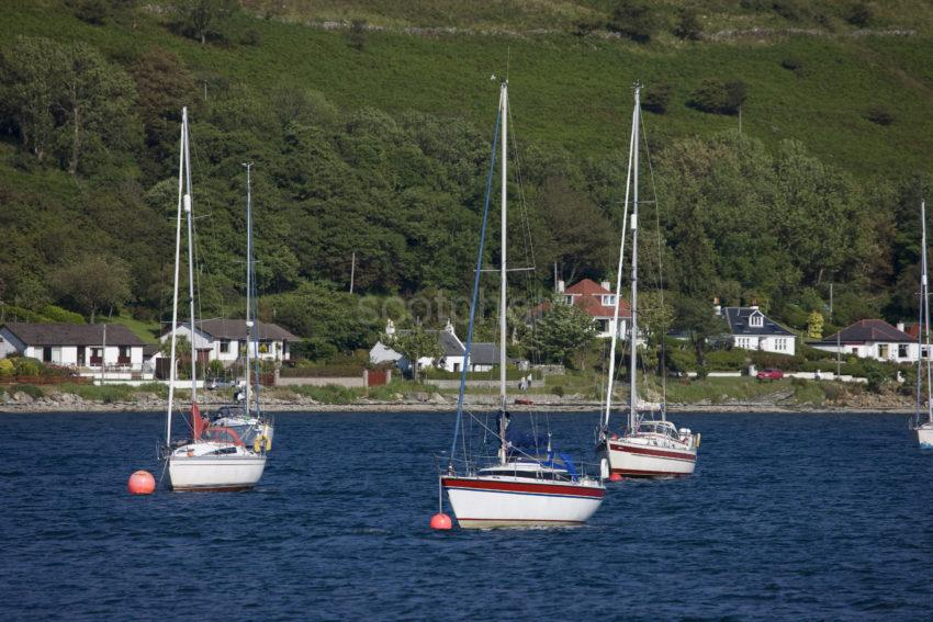 Yachts Bethed In Loch Ranza Adjacent To The Castle Arran