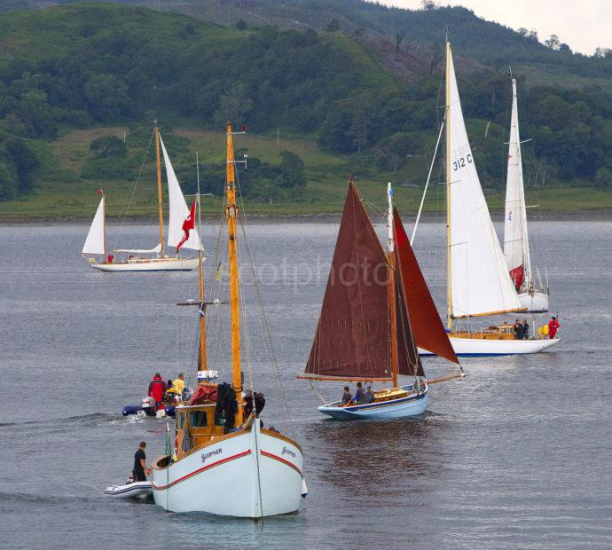 3X8G8571 Yachts Gather Outside Harbour Entrance TL