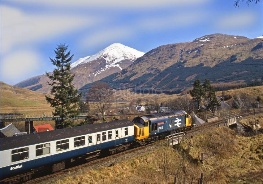 Class 37 With Oban Glasgow Train At Crianlarich With Ben More
