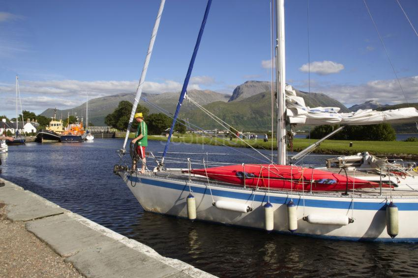 Yacht Enters Corpach Basin With Ben Nevis