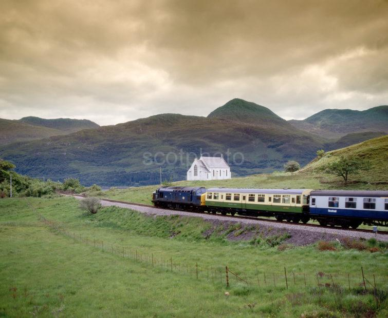 Class 37 With A Mixture Of Carraiges On Mallaig Line At Lochailort Church