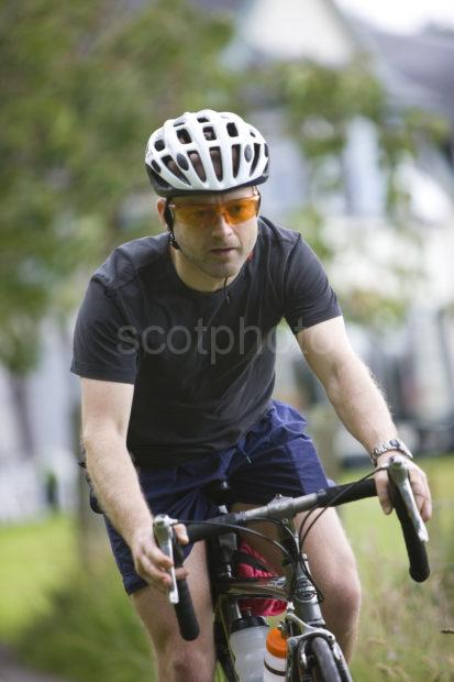 I5D8644 Cyclist On The Roads Of Argyll