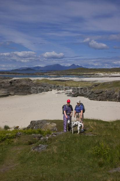 I5D6943 Tourist Walking Around Sanna Bay With Distant Rum Ardnamurchan