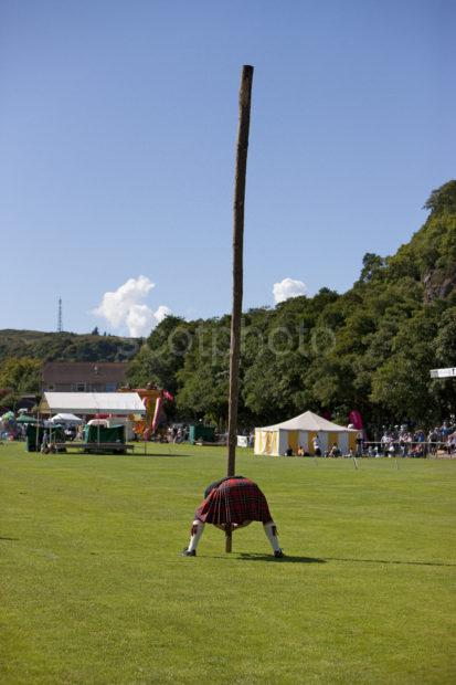 Preparing To Toss The Caber Oban Highland Games